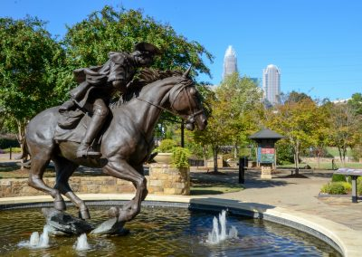 Captain James Jack statue in Elizabeth Park. Charlotte NC. Sitting in a fountain is the bronze statue. Famous in the revolutionary times.